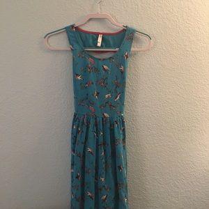 Blue bird pattered dress with heart cutout